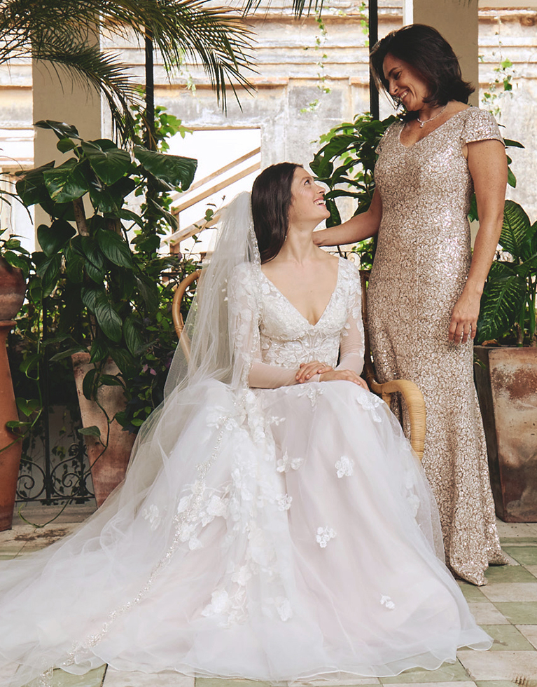 Mother of the bride wearing a dark dress with bride on her wedding day